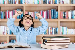 elementary-student-celebrating-her-success-in-library